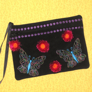 BUTTERFLY FRINGED FLOWER CLUTCH 5X7-in the hoop embroidery designs,in the hoop purse clutch with zipper,in the hoop butterfly and fringed 3 d flower embroidery design, in the hoop summer designs, in the hoop gift butterfly design
